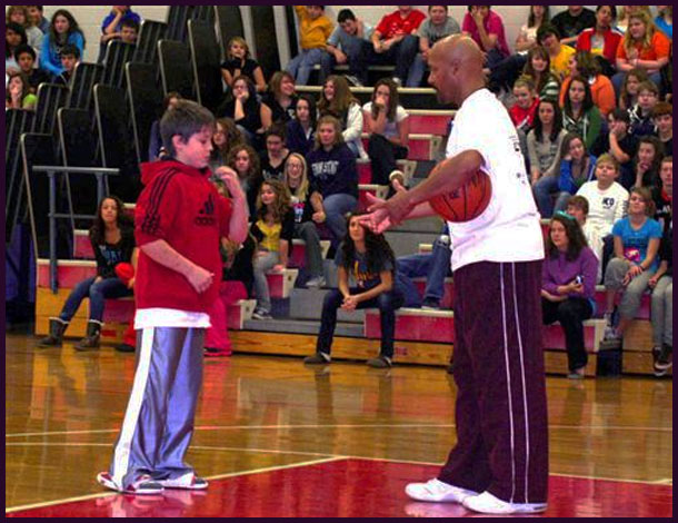 Derek �The Wizz� Murphy, right, talks with DuBois Area Middle School sixth-grader Dalton Kruzelak during an assembly at the school Thursday, Oct. 27. Murphy, a former Harlem Globetrotter basketball player, is now a motivational speaker with his Courts Around the World program.