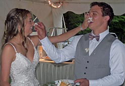 Congratulations to Danielle (Sciremammano) and Geno Morelli who were married yesterday, June 15th. The couple hosted their beautiful ceremony & reception outdoors at Geno's Moms house in Penfield. The picture shows that Danielle was the winner of their first icing battle as Newlyweds! .... YOU GO GIRL! Best of luck to the couple.