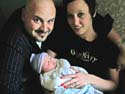 Corey and Myra Tost with the newest member of the family. Dakota Alan Tost was born on 8/21.